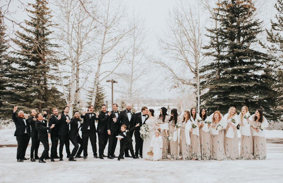 Wedding party outside with snow