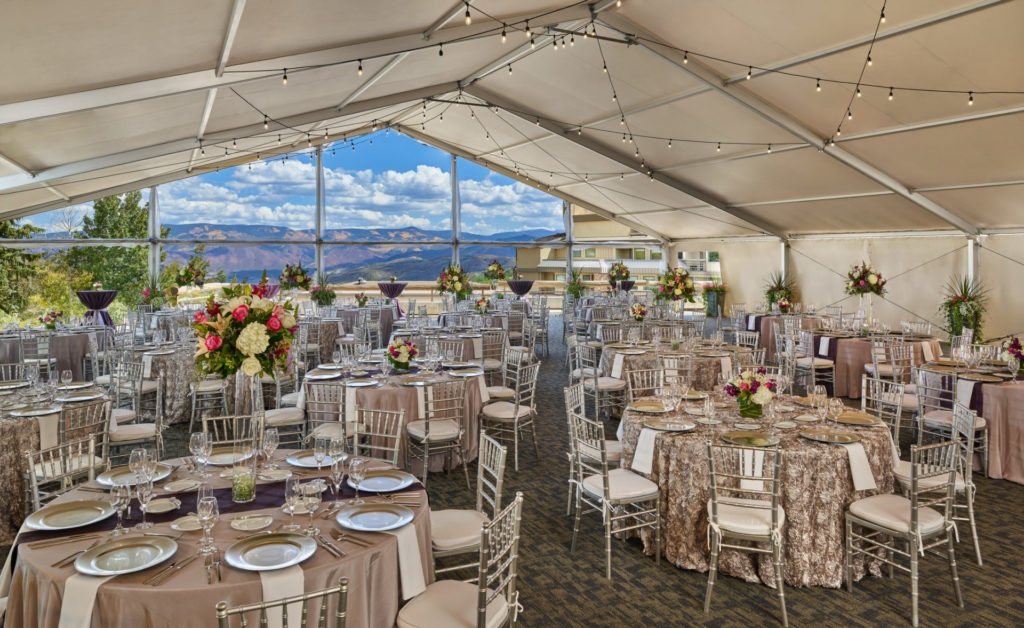 Dining tables covered by a tent outisde of Westin